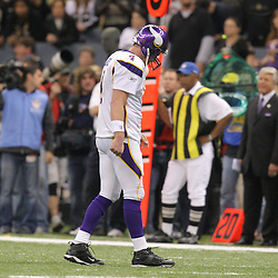 Jan 24, 2010; New Orleans, LA, USA; Minnesota Vikings quarterback Brett Favre (4) walks to the sideline following a offensive penalty in the fourth quarter of a 31-28 overtime victory by the New Orleans Saints over the Minnesota Vikings in the 2010 NFC Championship game at the Louisiana Superdome. Mandatory Credit: Derick E. Hingle-US PRESSWIRE