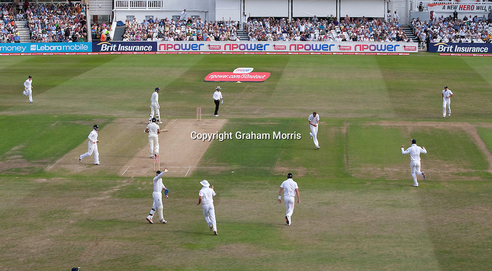 England celebrate the win as last man Sreesanth is bowled by Stuart Broad in the second npower Test Match between England and India at Trent Bridge, Nottingham.  Photo: Graham Morris (Tel: +44(0)20 8969 4192 Email: sales@cricketpix.com) 01/08/11