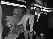 Big Tom McBride and Frank Burke.  (R75)..1988..16.03.1988..03.16.1988..16th March 1988..At the B & I ferryport in North Wall,Dublin a series of pictures of Big Tom McBride and Mr Frank Burke were taken...Image shows Tom McBride and Frank Burke pointing out some of the country's highlights on the sattelite image displayed in the B & I ferryport.