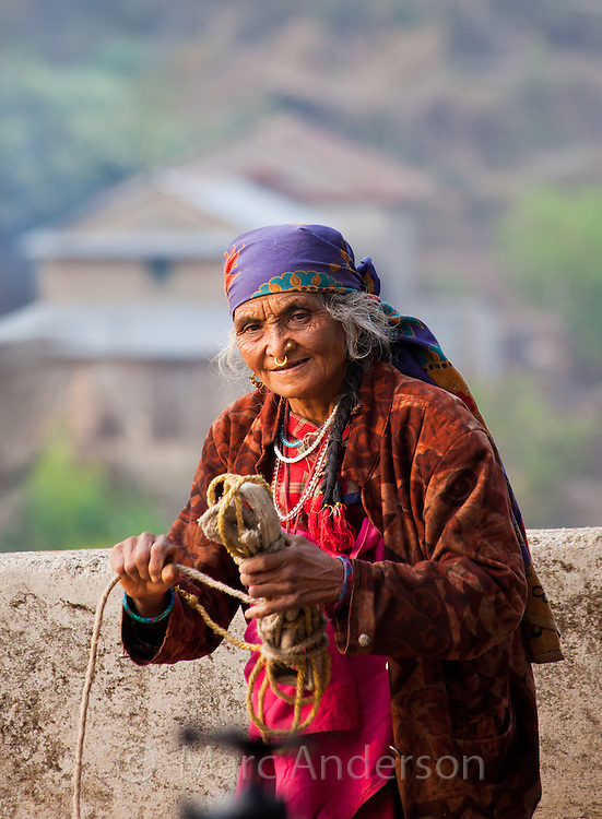 Old Nepalese woman with a nose ring and wearing a bandana, Helambu Region, Nepal