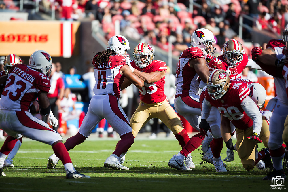 San Francisco 49ers strong safety Eric Reid (35) battles Arizona Cardinals wide receiver Larry Fitzgerald (11) at Levi's Stadium in Santa Clara, Calif., on November 5, 2017. (Stan Olszewski/Special to S.F. Examiner)