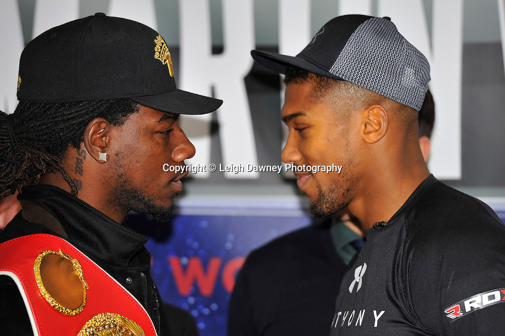 Charles Martin (L) and Anthony Joshua go head to head at the press conference at the Dorchester Hotel, Park Lane, London on the 19th February 2016, ahead of their IBF World Heavyweight Title fight. Photo credit: Leigh Dawney