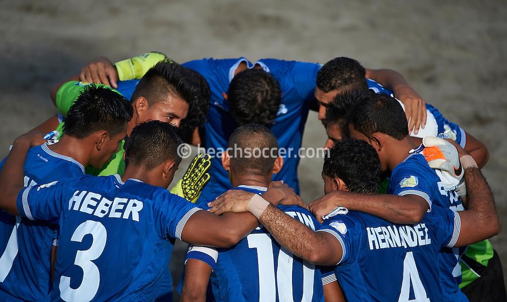 The El Salvador team huddle at the Copa Pilsener 2016.