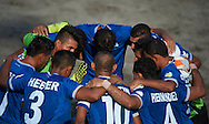 The El Salvador team huddle at the Copa Pilsener 2016.
