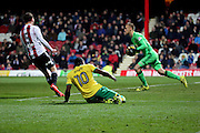 Brentford goalkeeper Daniel Bentley (1) saving shot from Norwich City striker Cameron Jerome (10) during the EFL Sky Bet Championship match between Brentford and Norwich City at Griffin Park, London, England on 31 December 2016. Photo by Matthew Redman.