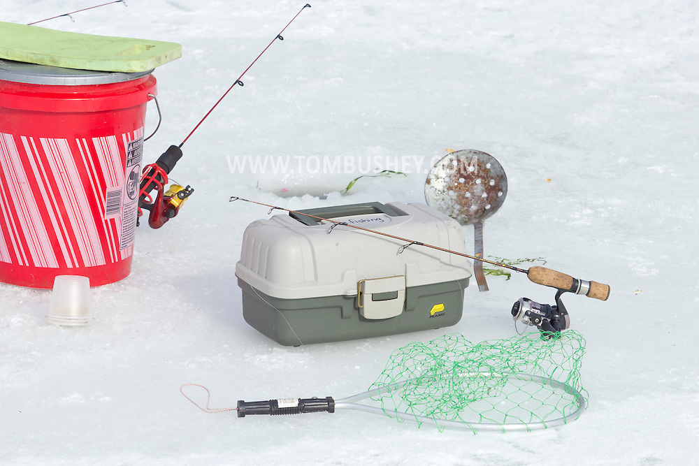 Middletown, New York - Ice fishing equipment at the Shawangunk Fish and Game Association pond during the association's annual contest on Feb. 8, 2014. ©Tom Bushey / The Image Works