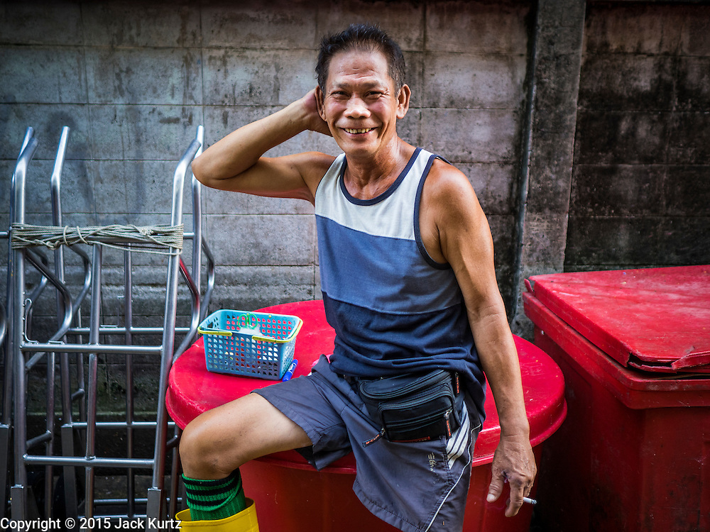 14 AUGUST 2015 - BANGKOK, THAILAND: A worker in Saphan Pla fish market in Bangkok. Saphan Pla fish market is the wholesale fish market that serves Bangkok. Most of the fish sold in Saphan Pla is farmed raised fresh water fish. The market is open 24 hours but it's busiest in the middle of the night and then again from about 7.30 until 11 in the morning.       PHOTO BY JACK KURTZ