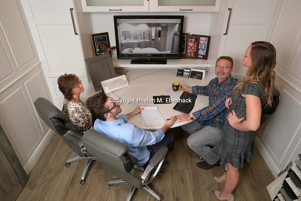 Keith Vellequette, second from right, owner and lead designer of KBF Design Gallery, talks about a project with family members Ashley, right, Melissa, left, and Adam at their showroom Monday, Sept. 18, 2017, in Altamonte Springs, Fla. (Photo by Phelan M. Ebenhack)