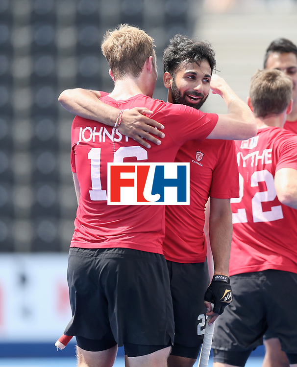LONDON, ENGLAND - JUNE 25: Gordan Johnston of Canada and Sukhi Panesar of Canada embrace after the 5th/6th place match between India and Canada on day nine of the Hero Hockey World League Semi-Final at Lee Valley Hockey and Tennis Centre on June 25, 2017 in London, England. (Photo by Alex Morton/Getty Images)