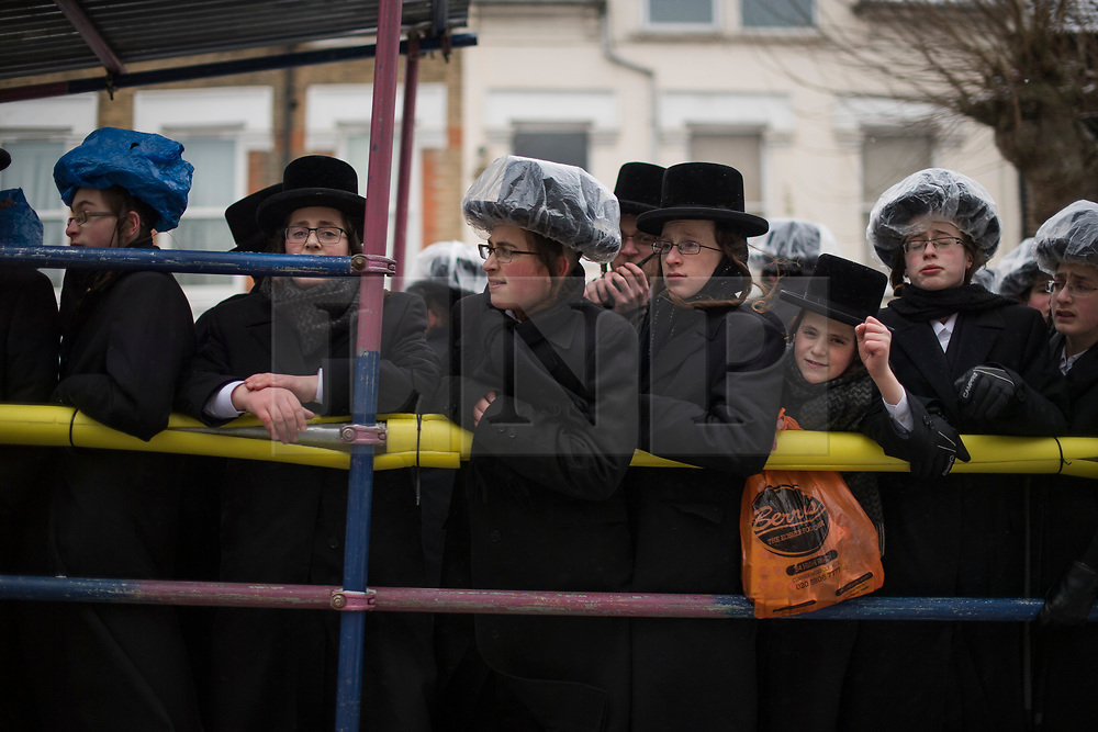 © Licensed to London News Pictures. 01/03/2018. London, UK. A group of young Orthodox Jewish men in traditional dress, ride in the back of a truck, playing music, as they celebrate the festival of Purim on the streets of Stamford Hill in north London on March 1, 2018. Purim celebrates the miraculous salvation of the Jews from a genocidal plot in ancient Persia, an event documented in the Book of Esther. Traditionally the jewish community wear fancy dress and exchange reciprocal gifts of food and drink. Photo credit: Ben Cawthra/LNP
