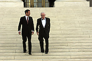 Supreme Court Justice John Roberts and Supreme Court Justice John Paul Stevens walk down the steps of the Supreme Court shortly after the investure ceremony for John Roberts on October 3, 2005.  Photograph: Dennis Brack