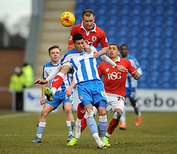 Bristol City's Aaron Wilbraham challenges for the header with Colchester United's Matthew Briggs - Photo mandatory by-line: Dougie Allward/JMP - Mobile: 07966 386802 - 21/02/2015 - SPORT - Football - Colchester - Colchester Community Stadium - Colchester United v Bristol City - Sky Bet League One