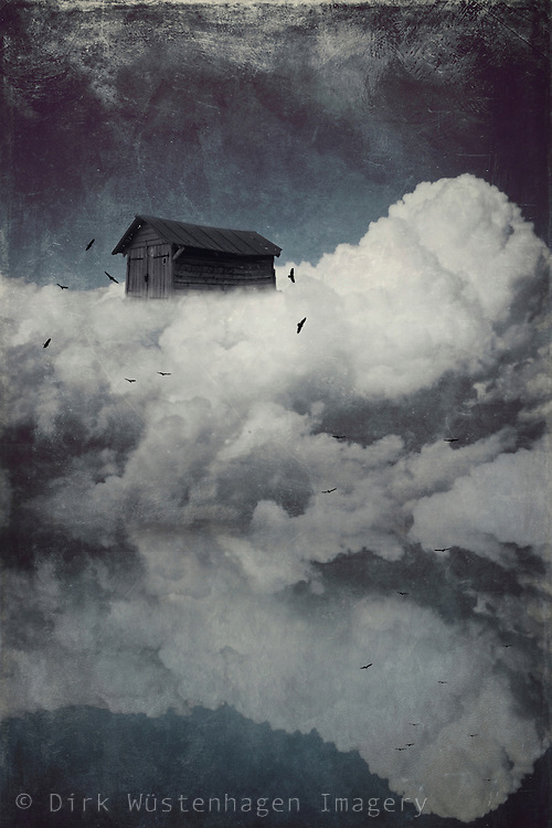 Surreal cloudscape with a wooden cabin and birds - manipulated photographs