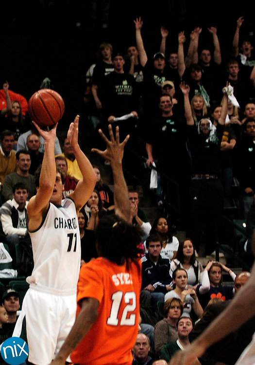UNC-Charlotte's Ian Anderson shoots a three against Clemson's Raymond Sykes at Halton Arena Saturday, Nov. 22. Clemson defeated the 49ers 71-70. Anderson made seven 3-pointers, the second most in team history.  (photo by James Nix)