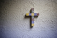 "OHIO, Toledo, October 27, 2012:  A cross on the wall of the basement of the ""Primera Iglesia Bautista"" where clothes and food is being distributed to hep homeless and people living under the poverty line. ALESSIO ROMENZI"