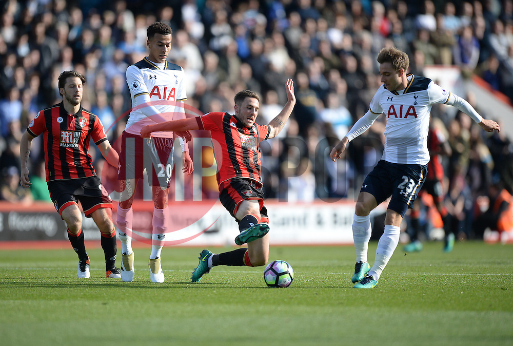 Dan Gosling of Bournemouth tackles Christian Eriksen of Tottenham Hotspur - Mandatory by-line: Alex James/JMP - 22/10/2016 - FOOTBALL - Vitality Stadium - Bournemouth, England - AFC Bournemouth v Tottenham Hotspur - Premier League