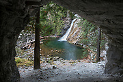 View Upper Priest River Falls from a cave, Selkirk Mountains, Idaho.