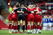 Liverpool women huddle during the FA Women's Super League match between Liverpool Women and Everton Women at Anfield, Liverpool, England on 17 November 2019.