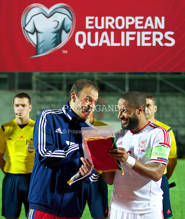 ANDORRA LA VELLA, ANDORRA - Tuesday, September 9, 2014: Wales' captain Ashley Williams and Andorra's Ildefons Lima Sola read an anti-racism statement before the opening UEFA Euro 2016 qualifying match at the Camp d'Esports del M.I. Consell General. (Pic by David Rawcliffe/Propaganda)