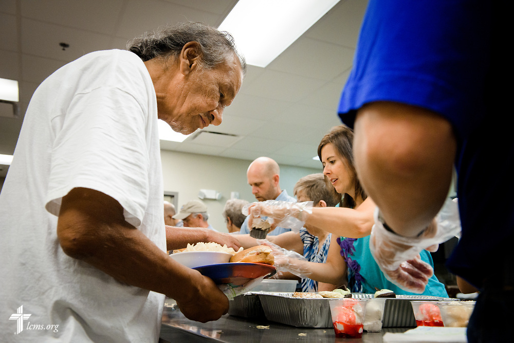 "Malcolm Big Bear prepares a plate of food with the help of  volunteers from Faith Lutheran Church, Sioux Falls, SD., at the Bishop Dudley Hospitality House homeless shelter on Tuesday, Aug. 1, 2017, in Sioux Falls. The meals are provided by a grant through the ""Stand With Your Community"" program, which was made possible by a partnership between the LCMS, Thrivent Financial and Lutheran Church Extension Fund. Big Bear said he was ""very thankful"" for the food and for the volunteers from Faith. LCMS Communications/Erik M. Lunsford"