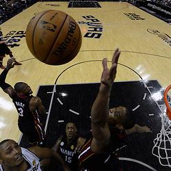 Jun 13, 2013; San Antonio, TX, USA; Miami Heat center Chris Bosh (1) blocks the shot of San Antonio Spurs center Boris Diaw (33) during the second half of game four of the 2013 NBA Finals at the AT&T Center. The Miami Heat defeated the San Antonio Spurs 109-93. Mandatory Credit: Derick E. Hingle-USA TODAY Sports