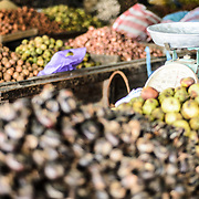 A set of old scales sits amongst an assortment of nuts and seeds for sale at the large and bustling morning market in Phonsavan in northeastern Laos. The people of the region are predominantly of Hmong ethnicity.