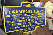 Erik Lindbergh, grandson of aviator Charles Lindbergh, participates in 85th anniversary celebration of his grandfather's historic solo flight across Atlantic, on Saturday May 19, 2012, at Cradle of Aviation museum, Long Island, New York. Significance of the 1927 flight of Lindbergh's Spirit of St. Louis which started at nearby Roosevelt Field, and ended at Le Bourget, France - was discussed, along with future of aviation, by panelists including Erik Lindbergh (purple shirt); plus, plaque commemorating the flight was rededicated. 10th anniversary of Cradle of Aviation opening and 35th anniversary of Charles A & Anne Morrow Lindberg Foundation were also celebrated.