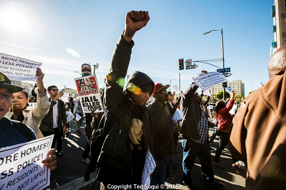 Hundreds of protesters march to the LAPD headquarters from the site of where a homeless man was shot and killed by an LAPD officer on March 1, 2015. LAPD state the homeless man tried to grab the LAPD officer's service weapon. The incident was captured on video from bystanders, and the video went viral overnight.