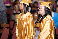 Victoria Hargrove (right) carries a photo of Jamycol Harris during the processional into the Thurgood Marshall High School commencement at the Dayton Masonic Center, Tuesday, May 24, 2011.