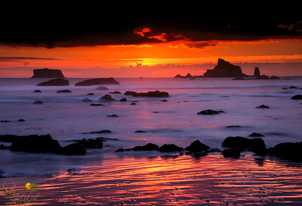 Sunset with red and dark sky at Rialto Beach in Olympic National Park