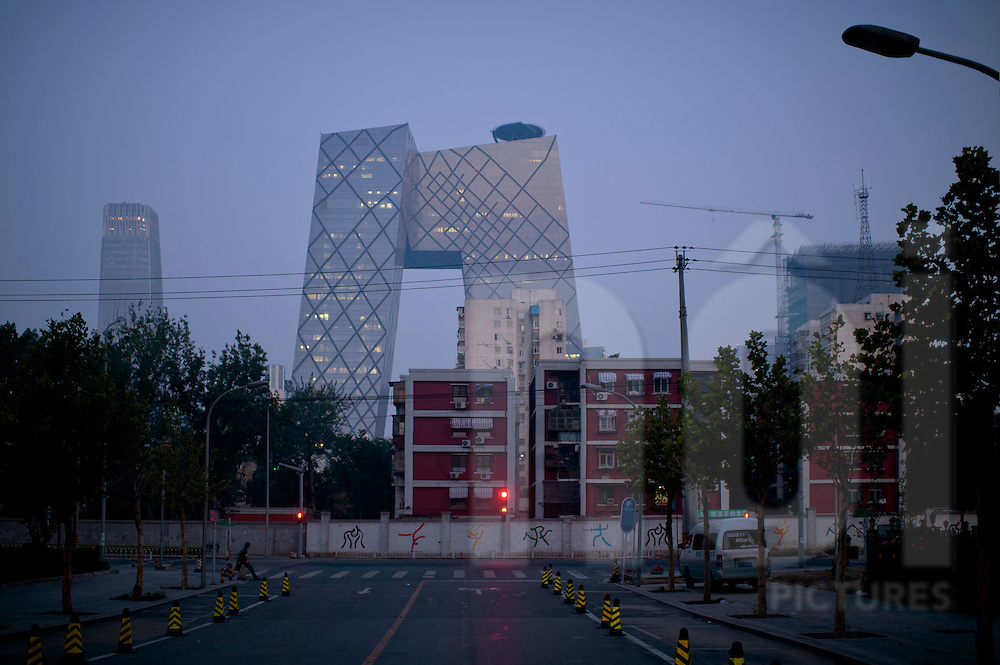 View of CCTV tower at sunset from a street in Chaoyang district, Beijing, China