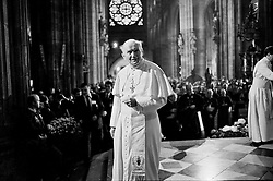 Pope John Paul II is  walking in the cathedral of Svaty Vit  in Prague a few weeks after the  Velvet revolution in Czechoslovakia.
