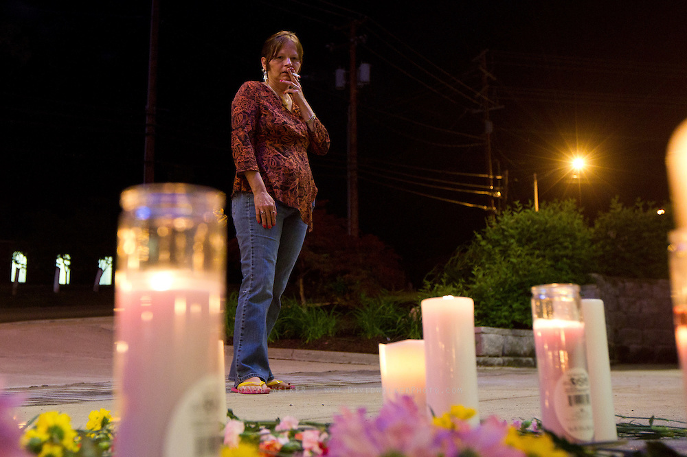 BRANSON, MO - APRIL 18: Dorthy Holtzclaw of Branson stands in front of flowers and candles placed on the ground during a candlelight vigil in honor of Dick Clark at Dick Clark's American Bandstand Theater on April 18, 2012 in Branson, Missouri.  (Photo by David Welker/Getty Images)*** Local Caption *** Dorthy Holtzclaw