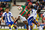 Portugal, FUNCHAL : Maritimo's Nigerian forward Maazou (C )  vies with Porto's Brazilian defender Alex Sandro (R ) during Portuguese League football match Maritimo vs F.C. Porto at Barreiros Stadium in Funchal on January  25, 2015. PHOTO/ GREGORIO CUNHA