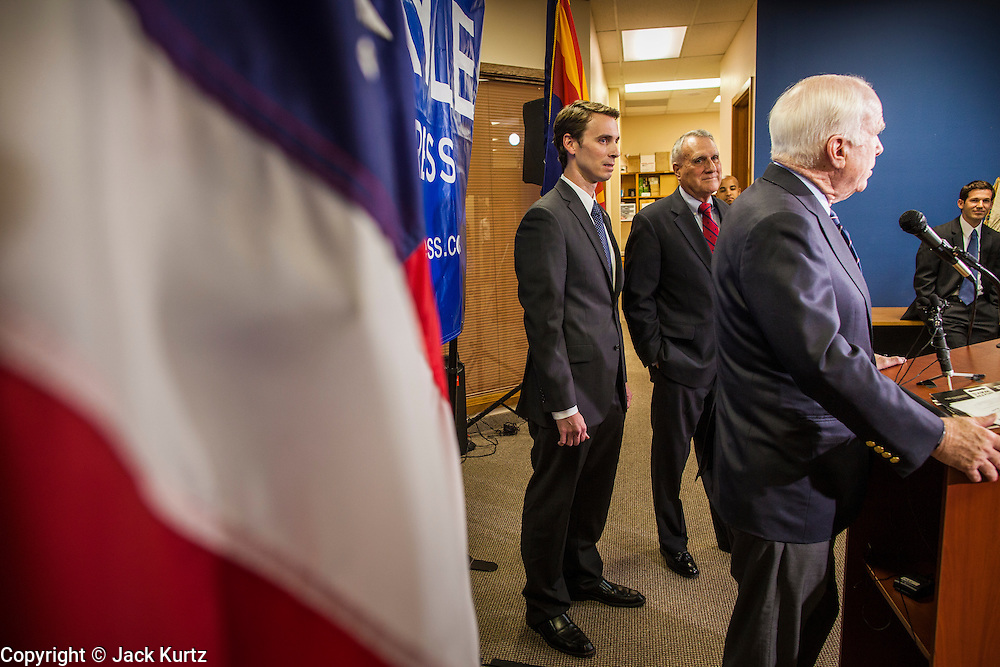 15 AUGUST 2012 - PHOENIX, AZ:  Sen. JOHN MCCAIN, Rep BEN QUAYLE and Sen JON KYL at a press conference Wednesday. Arizona's Republican US Senators, John McCain and Jon Kyl, announced their endorsement of Congressman Ben Quayle (R-AZ) during a press conference in Phoenix Wednesday. They decried the campaign being run by Quayle's opponent, Congressman David Schweikert (R-AZ). Both Quayle and Schweikert are freshman Congressmen from neighboring districts. They were thrown into the same district during the redistricting process and are now waging a bitter primary fight against each other.  PHOTO BY JACK KURTZ