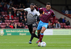 Anthony Grant of Peterborough United in action with Funso Ojo of Scunthorpe United - Mandatory by-line: Joe Dent/JMP - 21/10/2017 - FOOTBALL - Glanford Park - Scunthorpe, England - Scunthorpe United v Peterborough United - Sky Bet League One