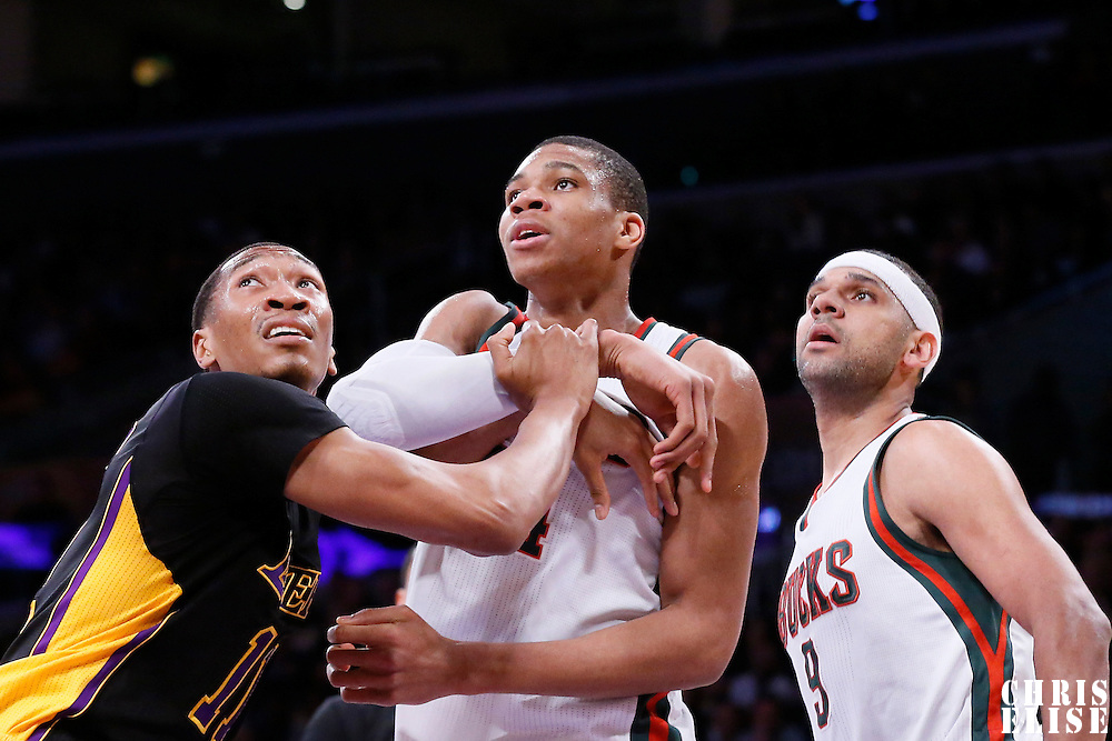27 February 2015: Milwaukee Bucks forward Giannis Antetokounmpo (34) vies for the rebound with Los Angeles Lakers forward Wesley Johnson (11) next to Milwaukee Bucks guard Jared Dudley (9) during the Los Angeles Lakers 101-93 victory over the Milwaukee Bucks, at the Staples Center, Los Angeles, California, USA.