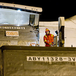 20100218 - LIEGE, BELGIUM - A TNT Express Worldwide S.A. cargo plane is unloaded, serviced, and reloaded, at the Liège Airport in Grâce-Hollogne, Belgium, on February, 2009. Approximately 90,000 packages move through TNT's main European hub every night. ( Photo © Patrick Mascart / Scorpix )