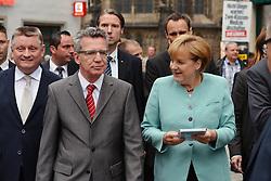 26.08.2013, Zwickau, GER, CD Wahlkampf, Bundeskanzlerin Angela Merkel besucht Zwickau, im Bild Bundeskanzlerin Angela Merkel (CDU) re. und Verteidigungsminister Thomas de Maiziere (li.) // during German Chancellor Angela Merkel visited Zwickau occasion of the CDU election program, Germany on 2013/08/26. EXPA Pictures © 2013, PhotoCredit: EXPA/ Eibner/ Bert Harzer<br /> <br /> ***** ATTENTION - OUT OF GER *****