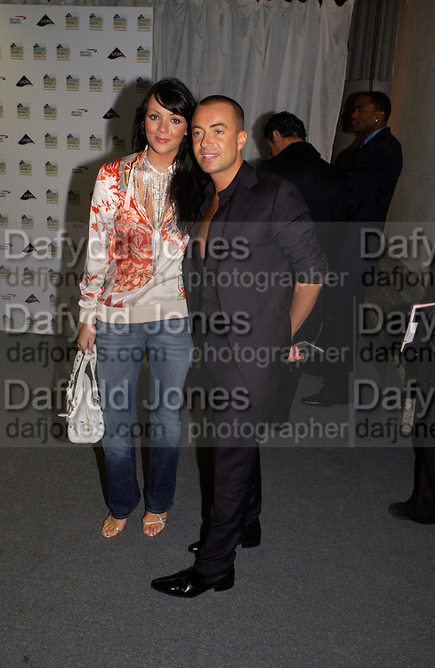 Julian Macdonald and Martine Mccutcheon, British Style Lycra fashion Awards, Old Billingsgate Market, 25 September 2003. © Copyright Photograph by Dafydd Jones 66 Stockwell Park Rd. London SW9 0DA Tel 020 7733 0108 www.dafjones.com