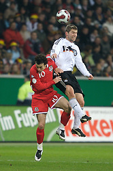 FRANKFURT, GERMANY - Wednesday, November 21, 2007: Wales' captain Simon Davies and Germany's Thomas Hitzlsperger during the final UEFA Euro 2008 Qualifying Group D match at the Commerzbank Arena. (Pic by David Rawcliffe/Propaganda)