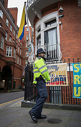 © Licensed to London News Pictures. 14/11/2016. London, UK. A policeman waits outside the Ecuadorian Embassy as Swedish Chief Prosecutor Ingrid Isgren interviews WikiLeaks editor-in-chief, Julian Assange. Assange, who has been living at the embassy for over four years, is wanted for questioning over accusations of rape in Stockholm in 2010. Photo credit: Peter Macdiarmid/LNP