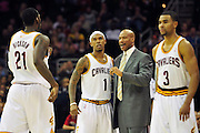 Jan. 28, 2011; Cleveland, OH, USA; Cleveland Cavaliers head coach Byron Scott talks with power forward J.J. Hickson (21) point guard Daniel Gibson (1) point guard Ramon Sessions (3) during the fourth quarter against the Denver Nuggets at Quicken Loans Arena. The Nuggets beat the Cavaliers 117-103. Mandatory Credit: Jason Miller-US PRESSWIRE
