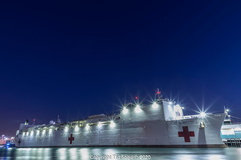 The USNS Hospital Ship Mercy is docked at the Port of Los Angeles and is now open to receive patients. The Mercy has 1000 beds and will treat non-Covid-19 cases, freeing up Los Angeles area hospitals to treat people with the virus.<br />