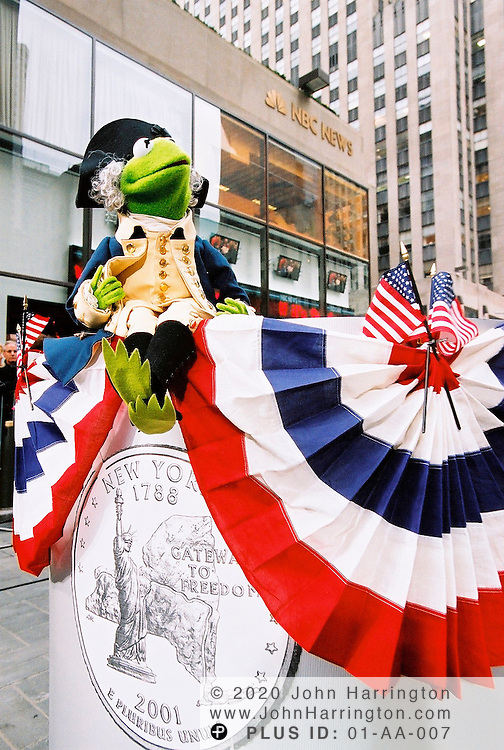 Kermit the Frog poses during a ceremony that unveiled the New York state quarter on Wednesday January 17, 2001.  The quarter was the 11th edition to be released in the series and was the first of 2001.  .