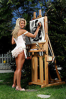 22 June 2005:  Stacia Robitaille wife of Luc Robitaille of the Los Angeles Kings painting outside in her lingere during The Not So Desperate, Desperate Housewives shoot on location in Los Angeles with NHL hockey players wives for Editorial Use Only!  Mandatory Credit:  Shelly Castellano.com or Price Doubles. .