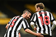 Notts County defender Richard Duffy (5) taps Notts County defender Elliott Hewitt (18) after he scores to put the Magpies 1-0 during the EFL Sky Bet League 2 match between Notts County and Blackpool at Meadow Lane, Nottingham, England on 29 April 2017. Photo by Jon Hobley.