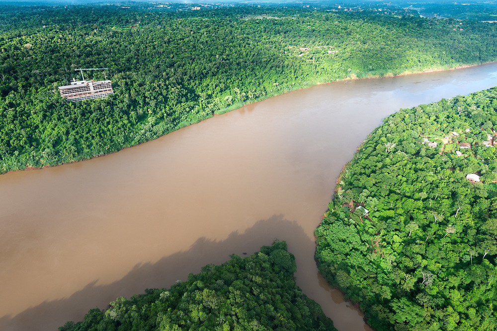 Aerial view of the Iguazu River on the border of Brazil and Argentina and Tamandua River