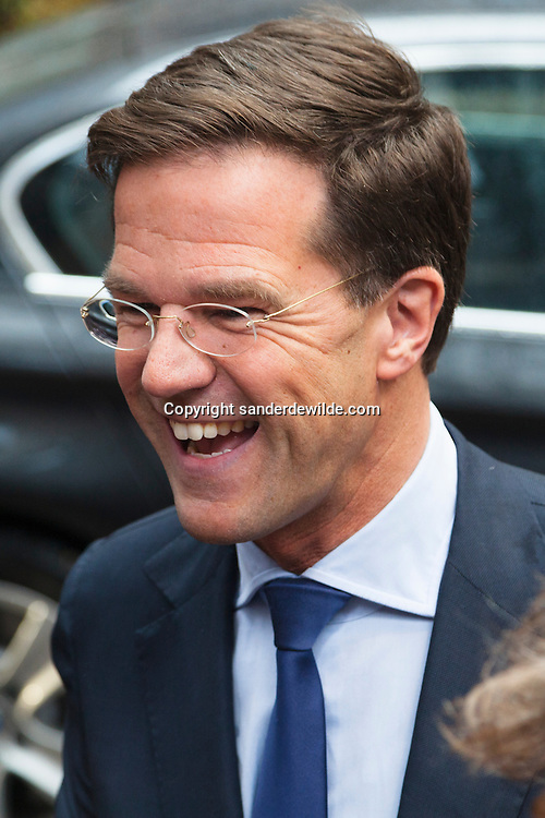 Mark Rutte, Dutch prime minister, talks to the media, smiling,  as he arrives for the first day of the European Leaders (EU) summit at the European Council headquarters in Brussels, Belgium, on Thursday, February 7, 2013. EU leaders braced for all-night negotiations in Brussels to try and strike a deal on EU spending for the next seven years