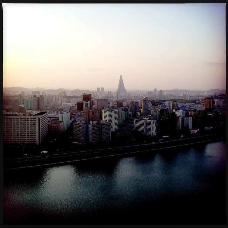 A view over the Taedong River and the capital of Pyongyang, North Korea. The Ryugyong hotel's pyramid shape visible in the distance.